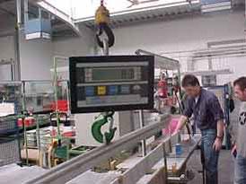 Utilización de la grúa de carga en la industria.